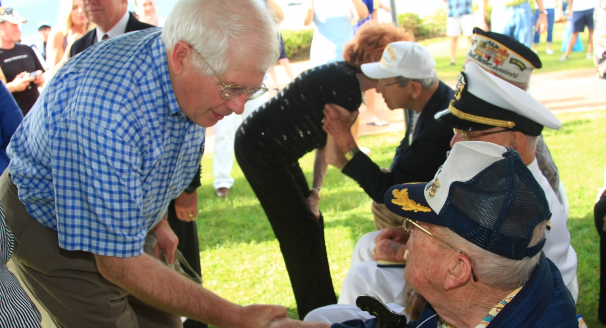 Congressman Price shaking hands with veterans.